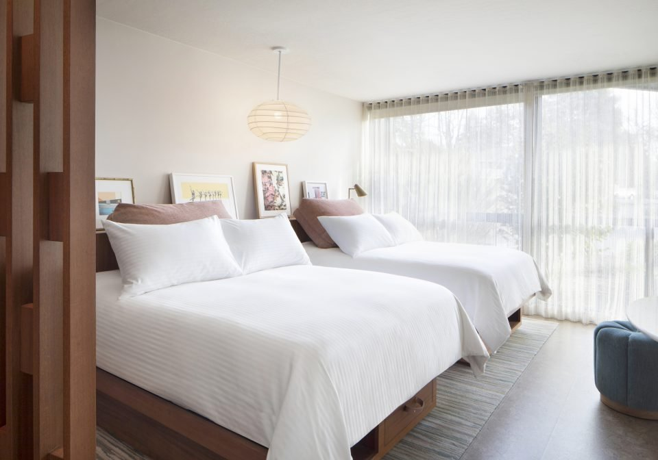 Two double beds in a Classic room at Flamingo Resort in Santa Rosa, CA.