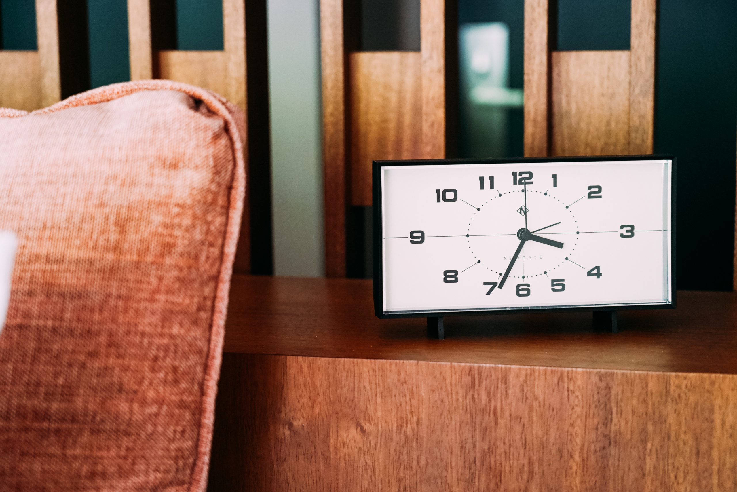 A clock on the night stand in a beautifully renovated Flamingo Resort room