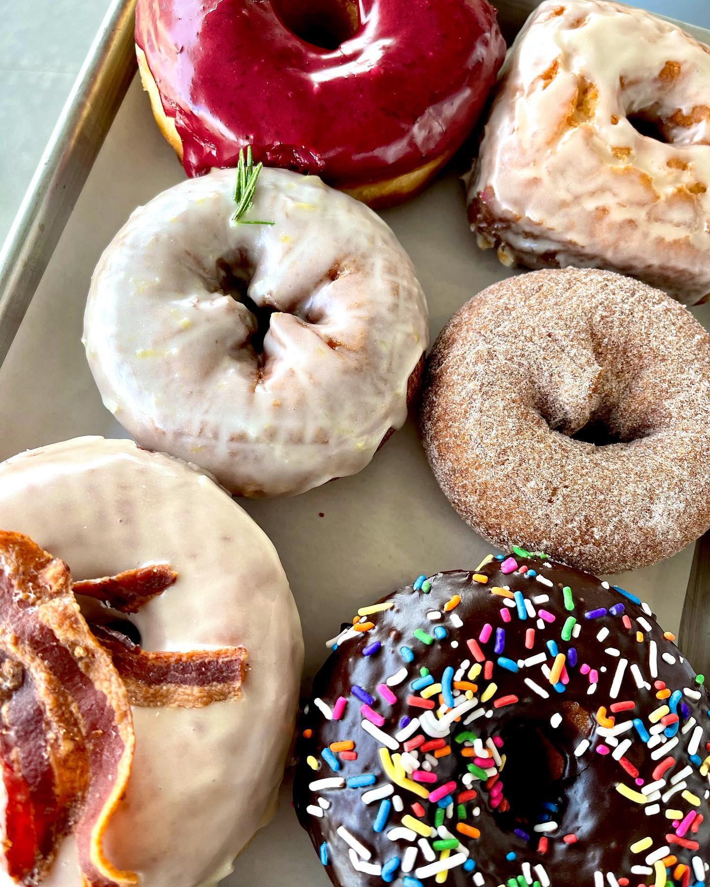 Delicious donuts with different coatings and toppings
